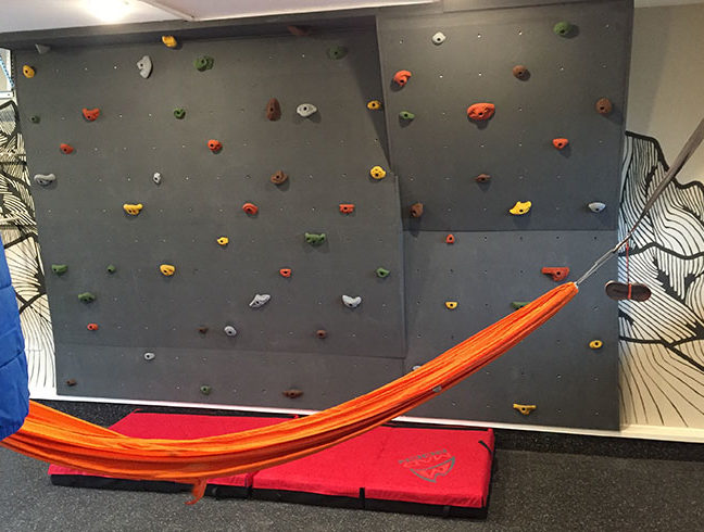 bouldering wall and hammock in garage