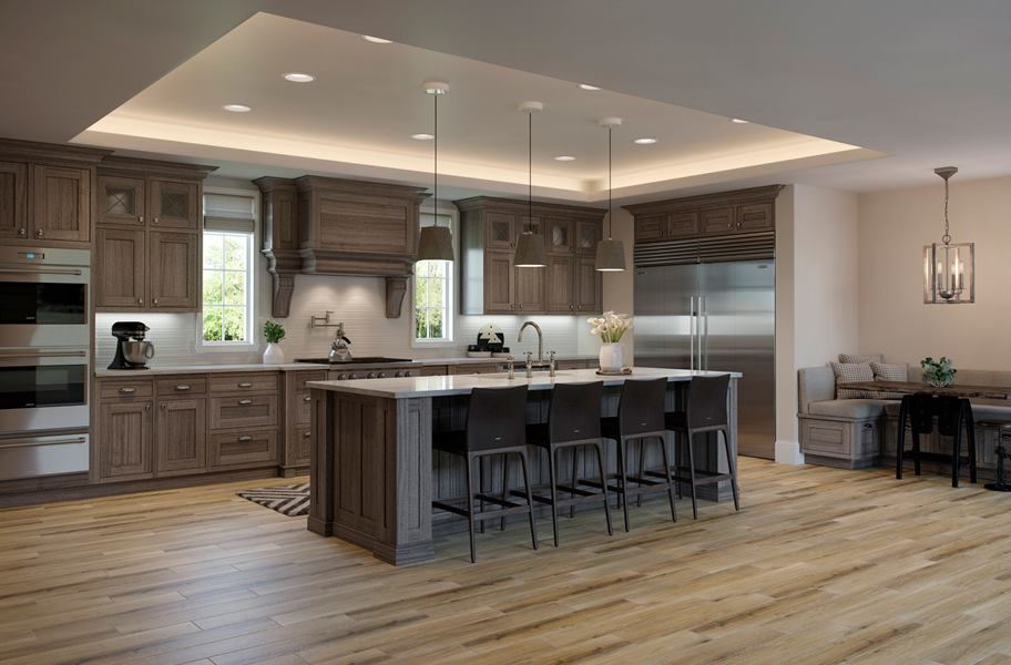 wood-look tile in modern kitchen with an island and cabinets