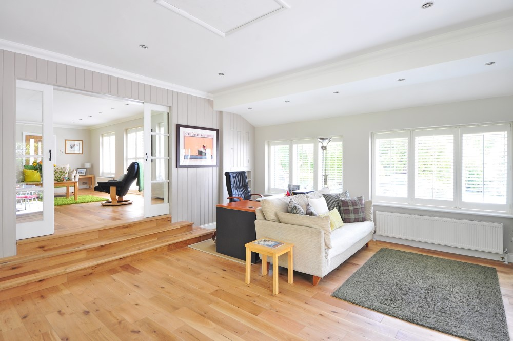 light hardwood floors in living room with white couch