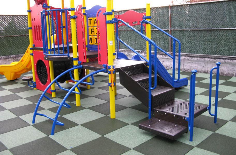 gray and white checkered playground flooring