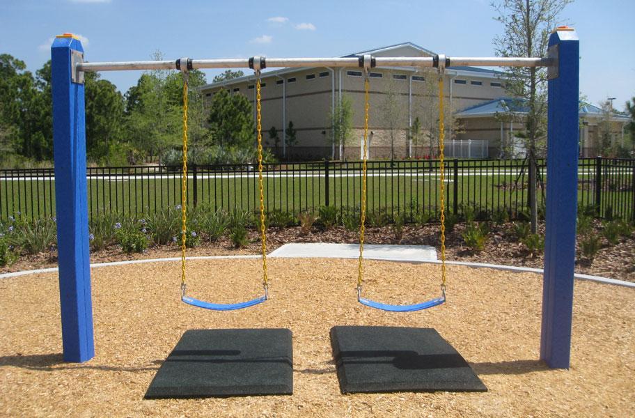 black swing mats under playground swings
