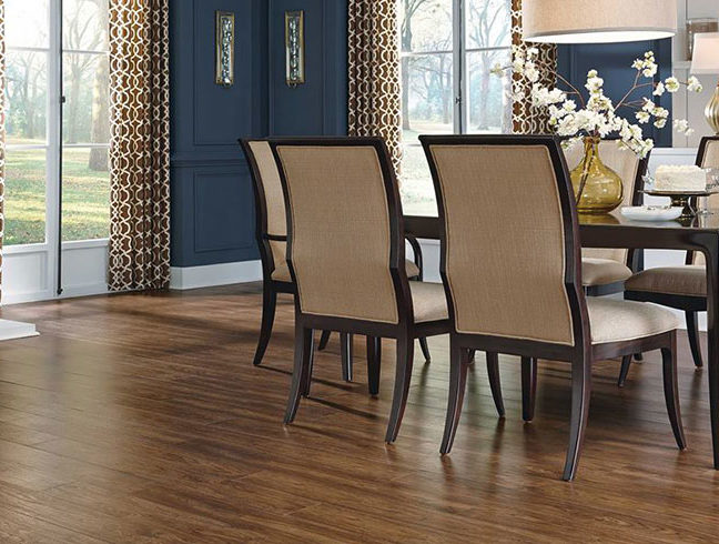 vinyl flooring in dining room with blue walls and dark furniture