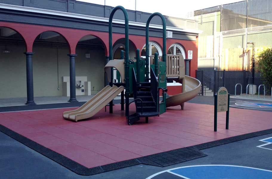 playground on top of red playground tiles