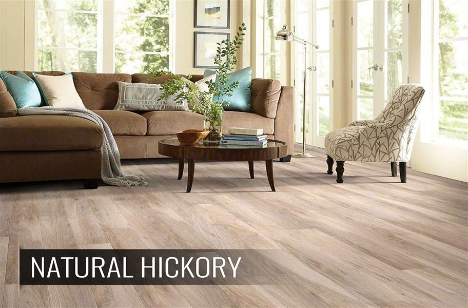 FlooringInc 2020 wood flooring trends: whitewashed wood planks in a living room