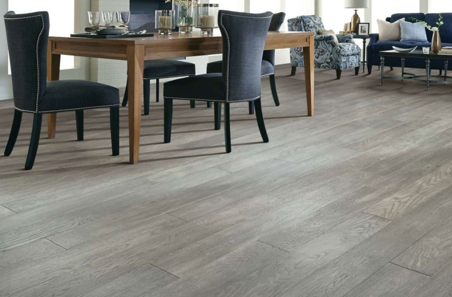 Gray wood floors in a dining room setting