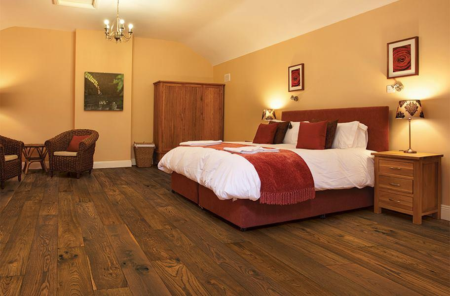 FlooringInc engineered wood flooring in a bedroom setting