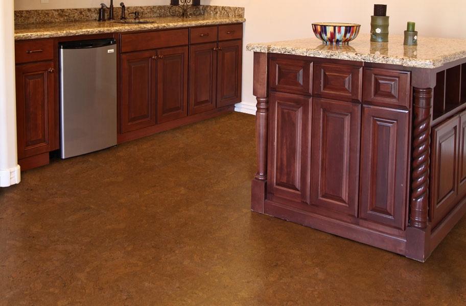 FlooringInc 2021 wood flooring trends: dark cork flooring in a kitchen