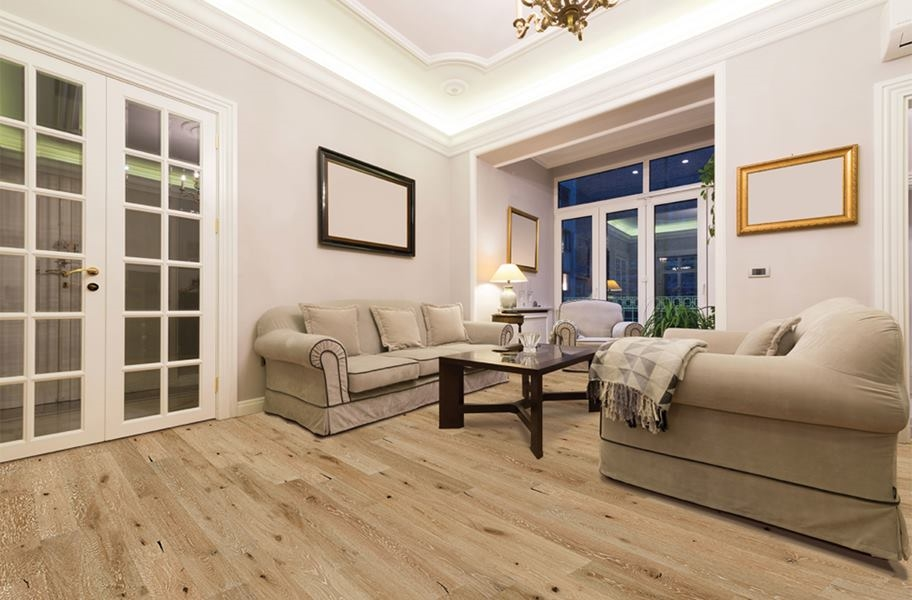 FlooringInc 2020 wood flooring trends: honey engineered wood planks in a living room setting
