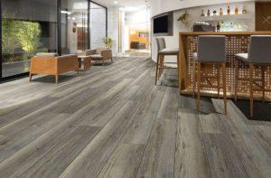 wiide plank wood-look flooring in a ktichen