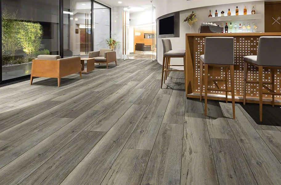 wiide plank wood-look flooring in a ktichen