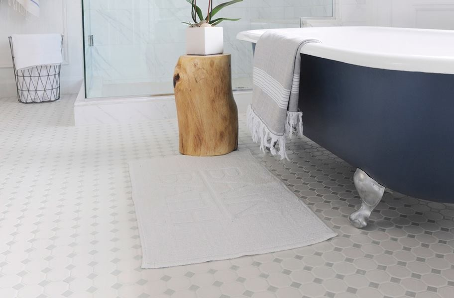 octagon dot tile floor mosaic in a bathroom setting