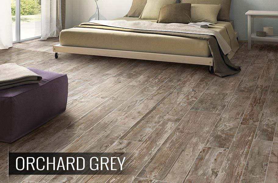 FlooringInc 2020 tile flooring trends: high variation wood-look tile plank in a bedroom setting