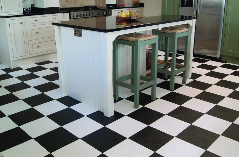 FlooringInc 2020 flooring trends: black and white flooring in a kitchen setting.