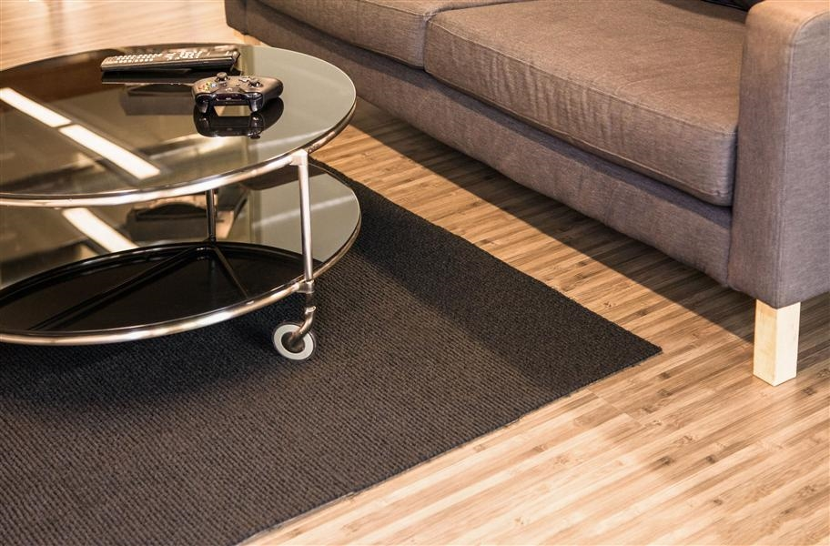 Area rug made of black berber carpet tile