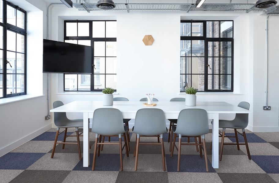 FlooringInc 2020 carpet trends: checker carpet tile pattern in an office
