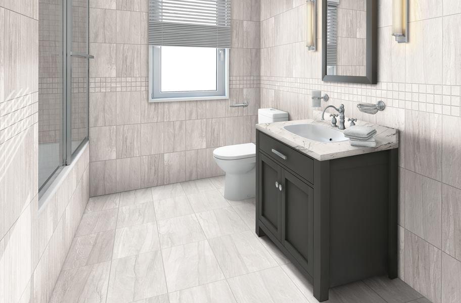FlooringInc 2020 tile flooring trends: Mixed finished tile flooring in bathroom setting.