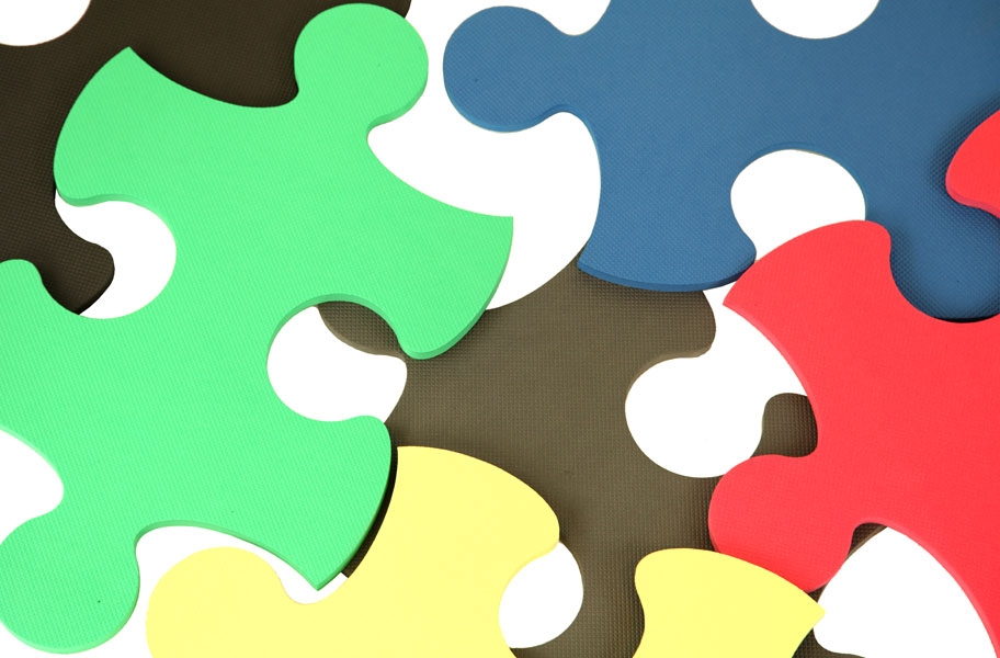 Close up view of foam tiles shaped like puzzle pieces