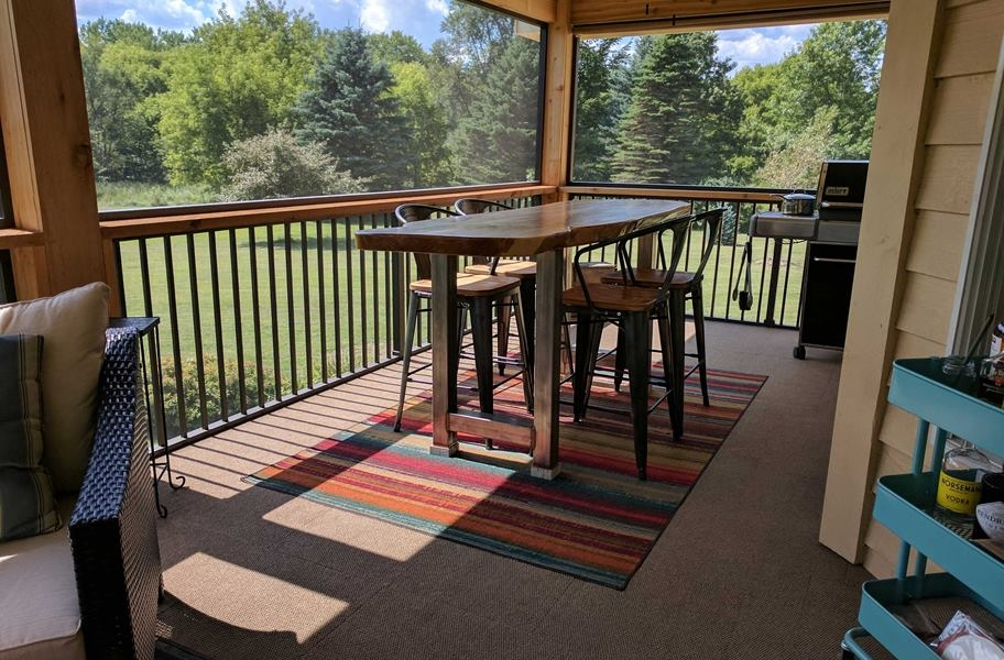 outdoor carpet in an enclosed porch setting