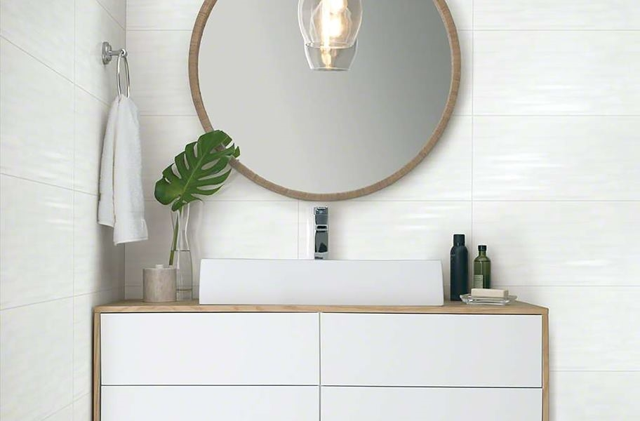 Light wall and floor tile in a bathroom setting