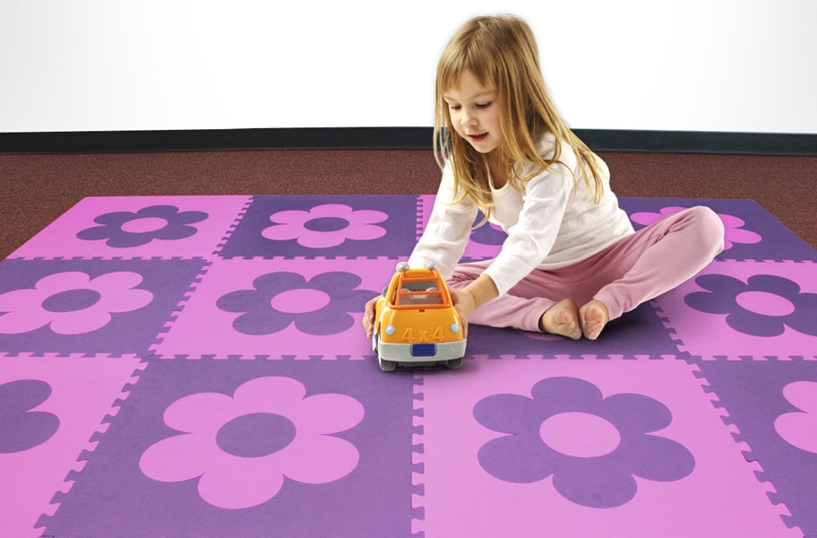 Child playing with a toy on a eva foam play mat