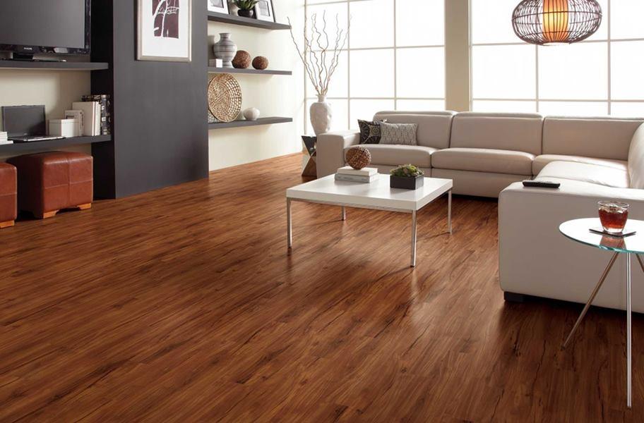 Waterproof vinyl planks in a living room setting.