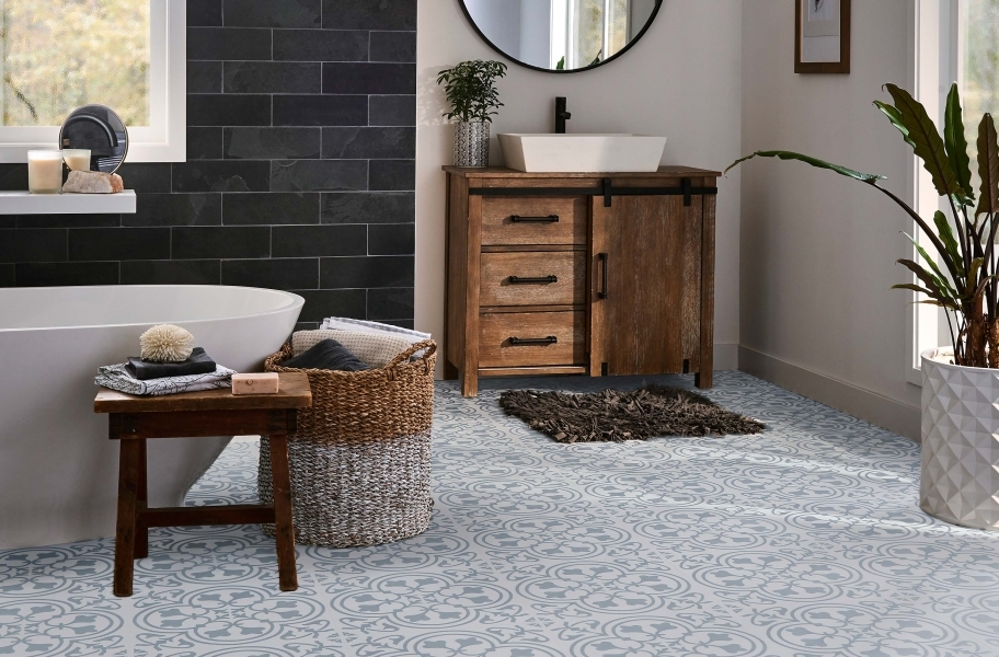 FlooringInc 2020 vinyl flooring trends: decorative geometric patterned vinyl planks in a bathroom setting.