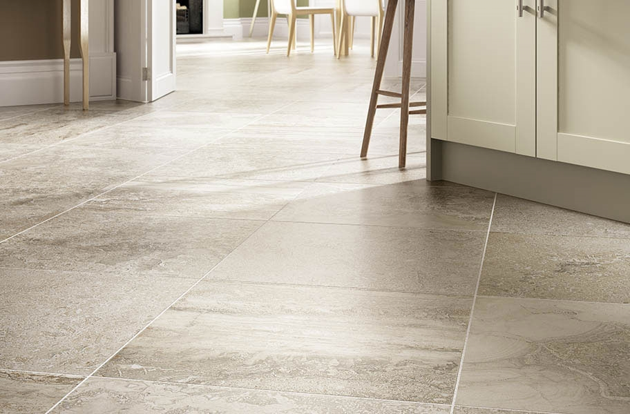 Large format stone-look tile flooring in a kitchen setting