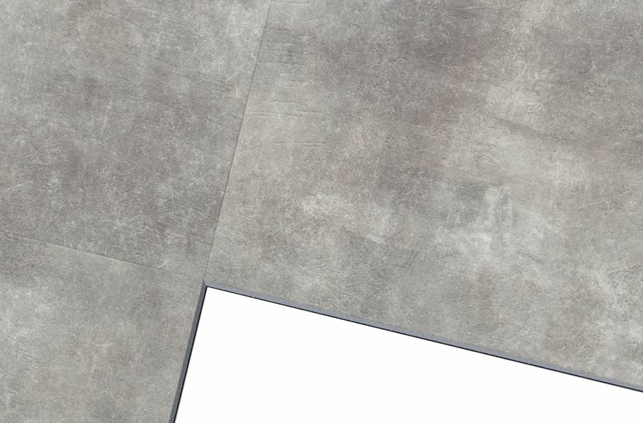 close up view of concrete-look vinyl tiles