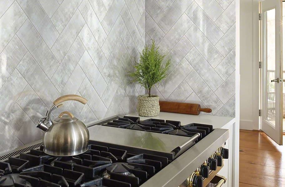 Herringbone patterned tile in a kitchen backsplash