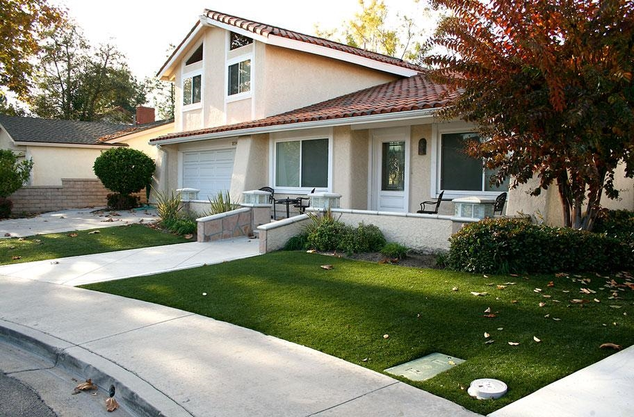 Artificial turf lawn in front of a home
