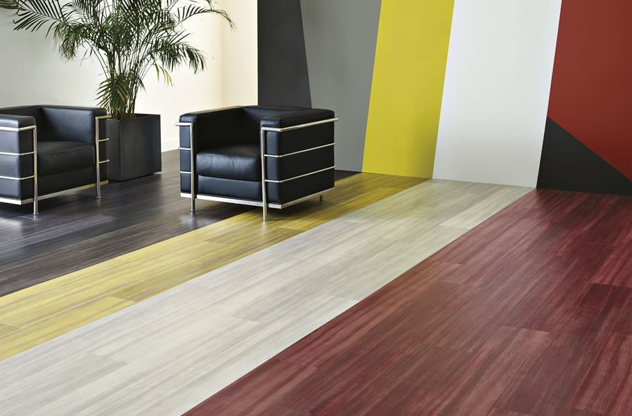 FlooringInc 2020 vinyl flooring trends: colorful wood-look vinyl plank in a commercial setting