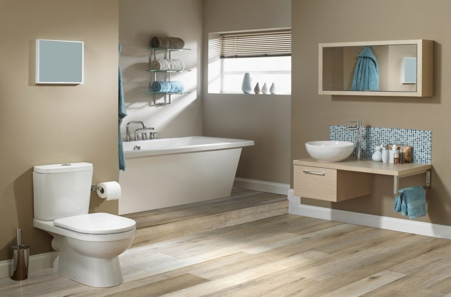 blond wood-look vinyl planks in a bathroom setting