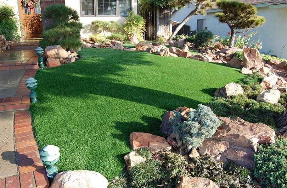 FlooringInc artificial grass infill guide: Catalina cool turf rolls in a front lawn.