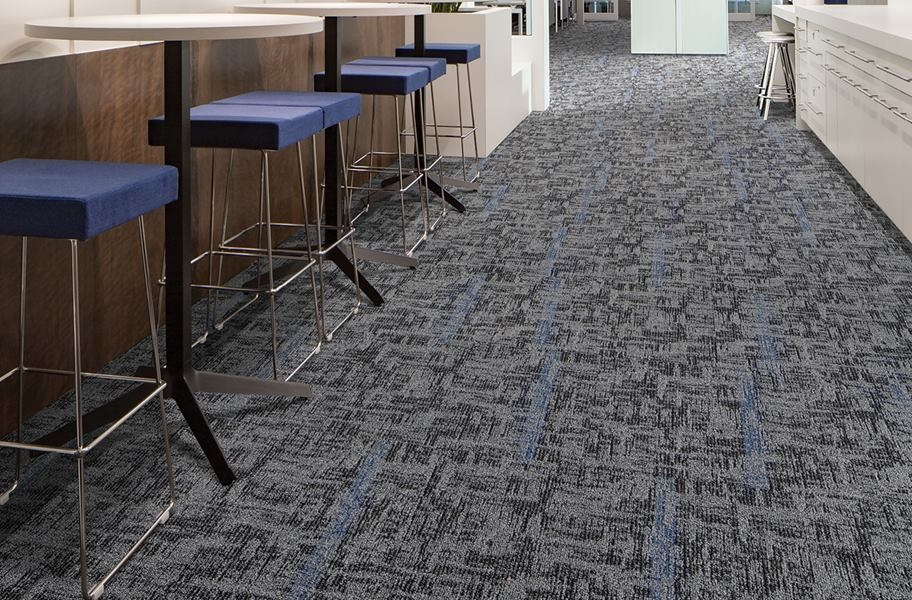 geometric patterned carpet tile in a commercial setting