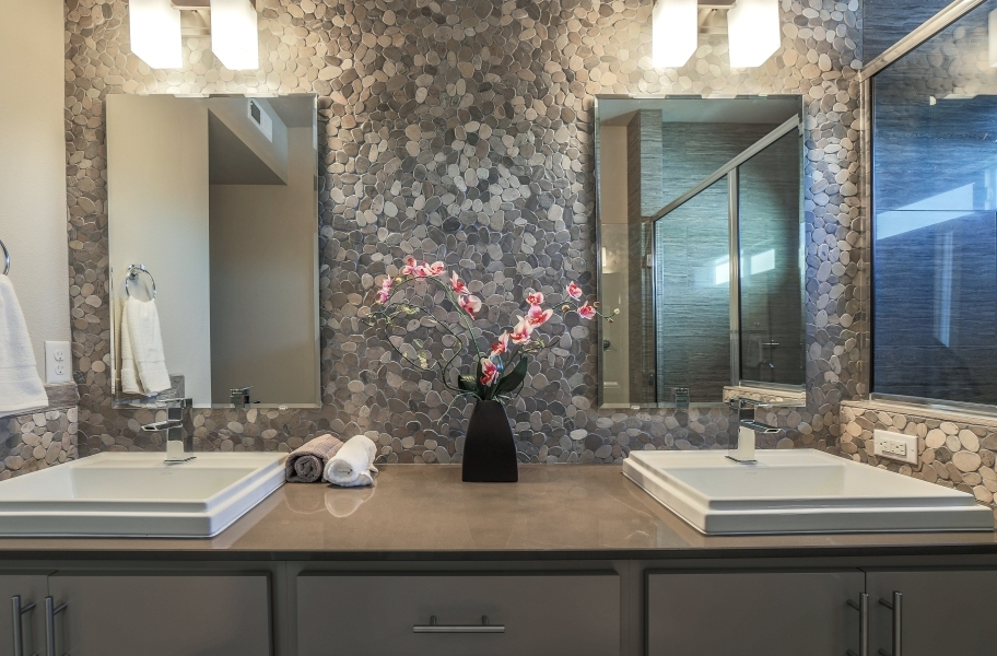 Accent Wall Ideas: stone pebble accent wall backsplash in a bathroom