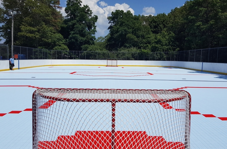 Court flooring install: Outdoor hockey field made from court floor tiles