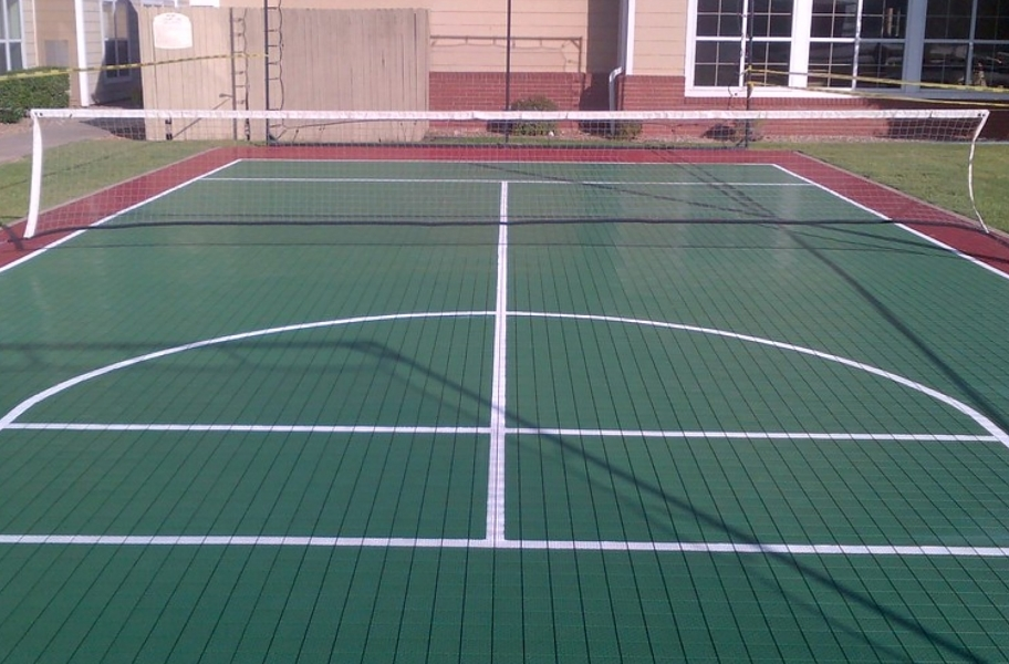 DIY court flooring installation guide: outdoor sports tiles in a backyard court.