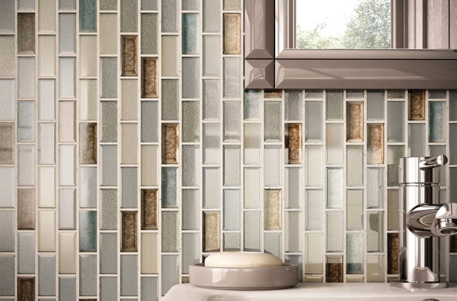 Glass mosaic tile backsplash in a bathroom