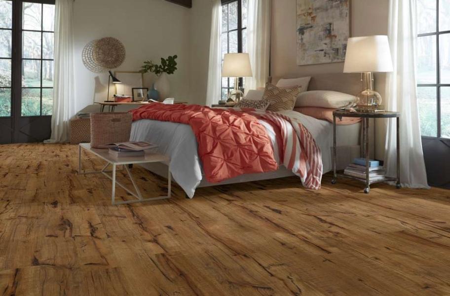 Handscraped laminate flooring in a bedroom setting