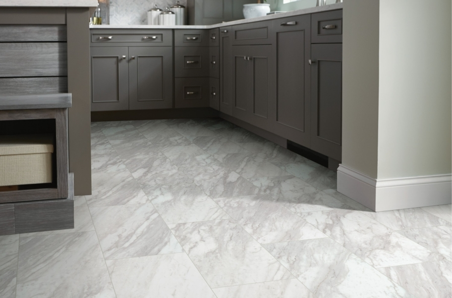 """Gray cabinetry paired with Shaw Paragon Tile Plus 12"""" Rigid Core Vinyl Planks"""