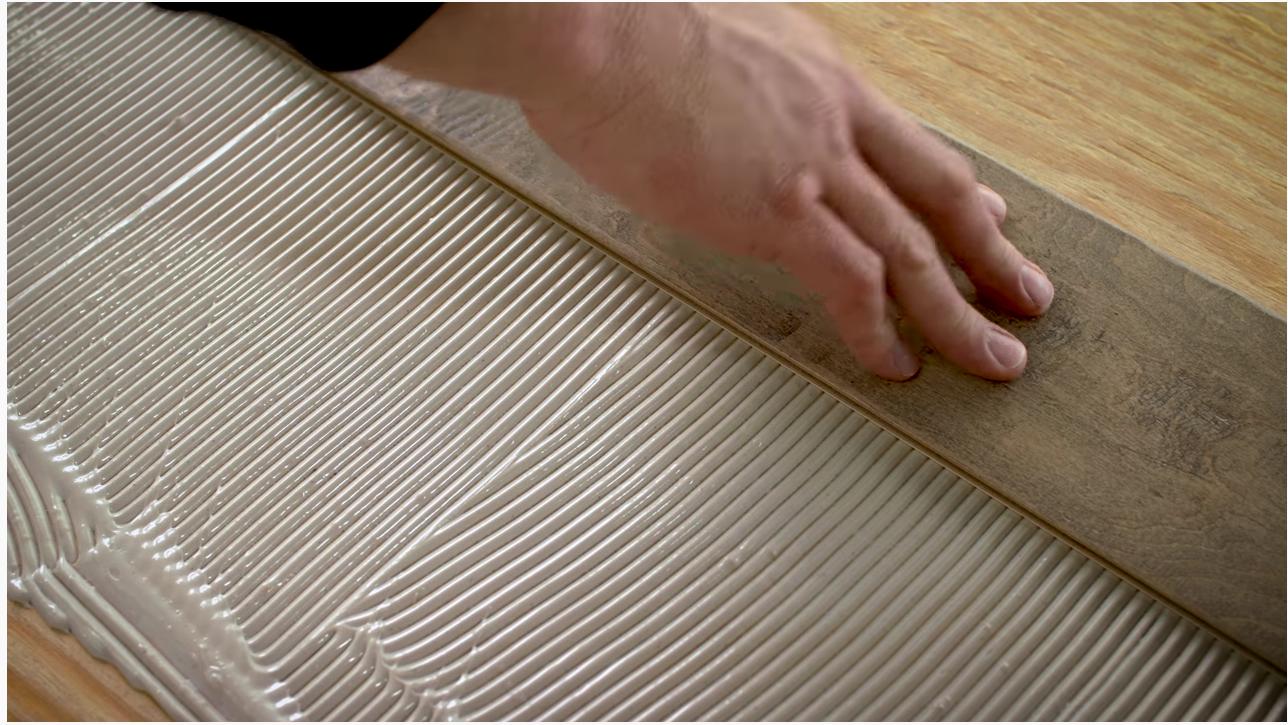 Glue-down method of engineered hardwood installation- Shaw Floors
